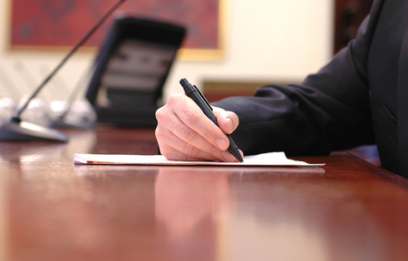 Businessman working on the contract, business  meeting , contract signing concept .