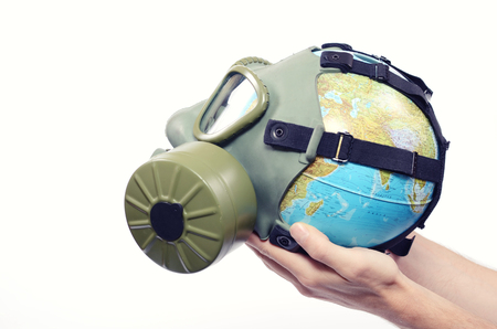 mankind: Global Earth and environmental pollution concept, Globe with gas mask isolated Stock Photo