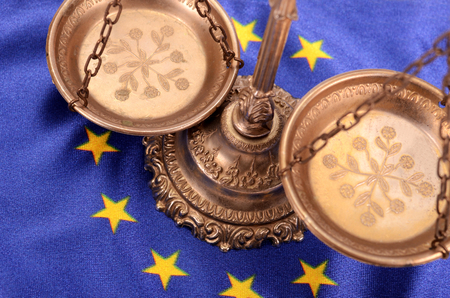litigate: Scales of justice and Flag of European union , European union law concept