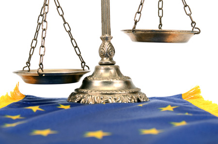 Scales of justice and Flag of European union , European union law concept.