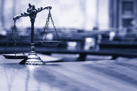 Symbol of law and justice in the empty courtroom, law and justice concept , blue toned.