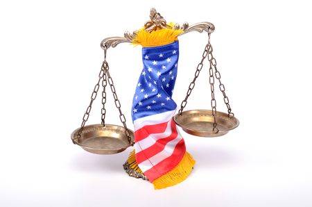 Scales of justice rolled up with  American flag, law and justice concept. Stock Photo