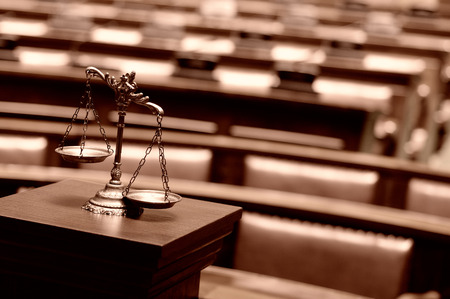 litigate: Symbol of law and justice in the empty courtroom, law and justice concept, golden , sepia, bronze toned.