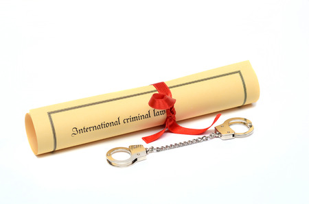 prison system: Handcuffs and International criminal law, law concept, isolated on the white background.
