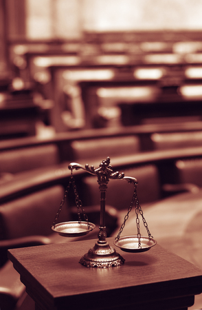 litigate: Symbol of law and justice in the empty courtroom, law and justice concept. Stock Photo