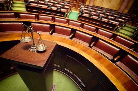 trial: Symbol of law and justice in the empty courtroom, law and justice concept. Stock Photo
