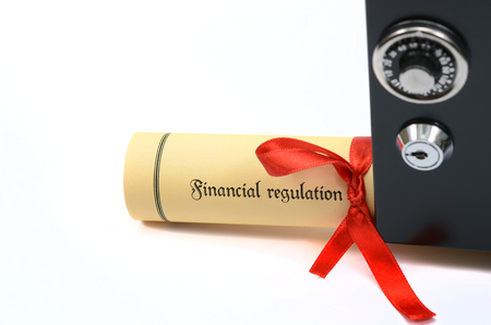 Financial regulation and steel safe on the white backround. Stock Photo