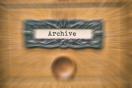 The Archives Card Catalog , old wooden file catalog box, index , database, archive and library concept. Stock Photo