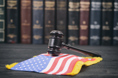 Law and Justice, Legality concept, Law library, Judge Gavel and United States of America flag on a black wooden background.