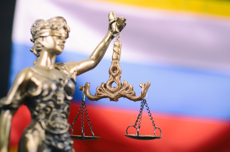 Law and Justice, Legality concept, Scales of Justice, Justitia, Lady Justice in front of the Russian flag in the background. Stock Photo