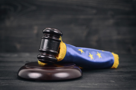 Law and Justice, Legality concept, Judge Gavel and European Union flag on a black wooden background. Standard-Bild