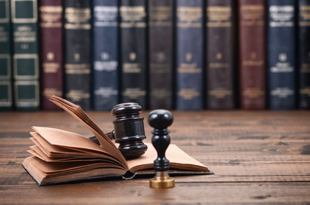 Law and Justice, Legality concept, Notary Seal, Judge Gavel and Law book on a wooden background. Stock Photo