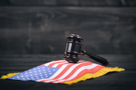 Law and Justice, Legality concept, Judge Gavel and United States of America flag on a black wooden background. Stock Photo