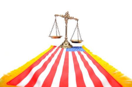 Scales of justice and flag of United States of America