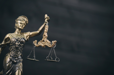 Law and Justice, Legality concept, Scales of Justice, Justitia, Lady Justice on a black wooden background. Stock Photo