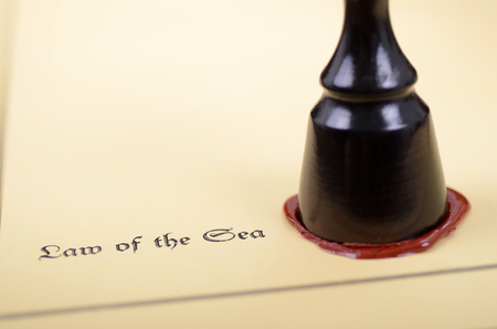 Law of the sea, Scales of Justice , Notary seal, legality concept.