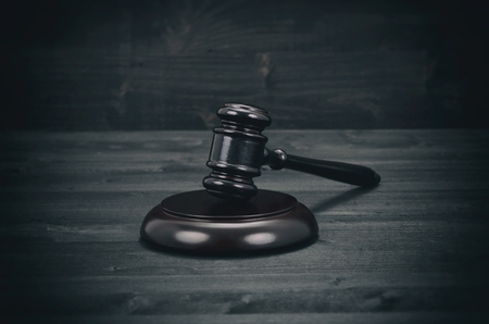 Law and Justice, Legality concept, Judge Gavel on a black wooden background. Stock Photo