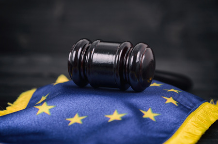 Law and Justice, Legality concept, Judge Gavel and European Union flag on a black wooden background. Stock Photo