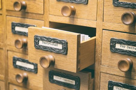 The Archives Card Catalog , old wooden file catalog box, index , database, archive and library concept. Banque d'images