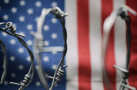 Barbed wire and United States of America flag , immigration  concept. Stock fotó - 138370000