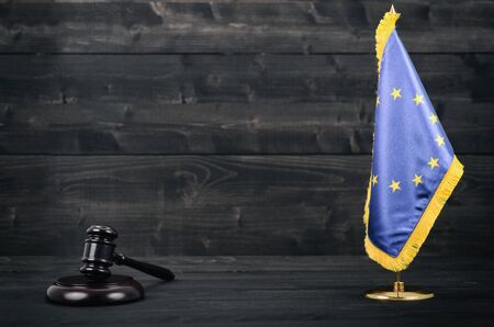 Law and Justice, Legality concept, Judge Gavel and European Union flag on a black wooden background. Banco de Imagens