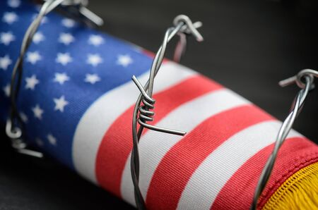 Barbed wire and United States of America flag , immigration  concept.
