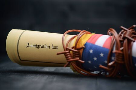 Barbed wire , Immigration Law and flag of United States Of America, immigration concept Stock fotó