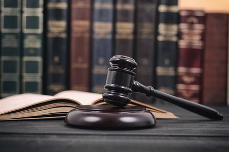Law and Justice , Legality concept, Judge Gavel and law book on a black wooden background, law library concept.