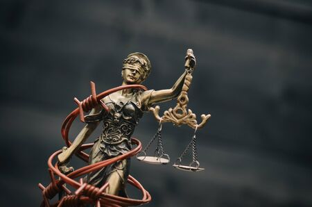 Law and Justice, Legality concept, Scales of Justice, Justitia, Lady Justice on a black wooden background. Фото со стока