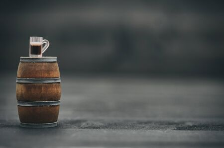 Wooden barrel and beer mug, beer industry concept.