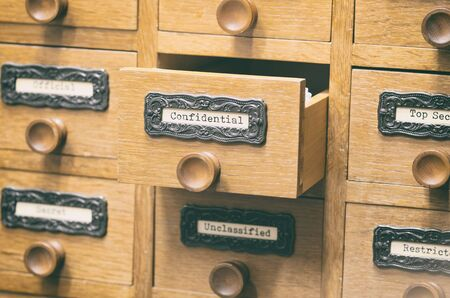 The Archives Card Catalog , old wooden file catalog box, index , database, archive and library concept. Фото со стока