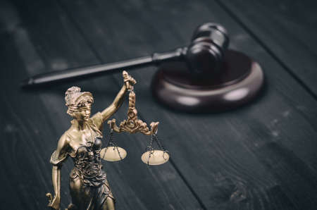 Law and Justice, Legality concept, Scales of Justice, Judge Gavel, Justitia, Lady Justice on a black wooden background.