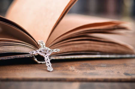 Christian cross necklace on a Holy Bible, Christianity and Religion concept.