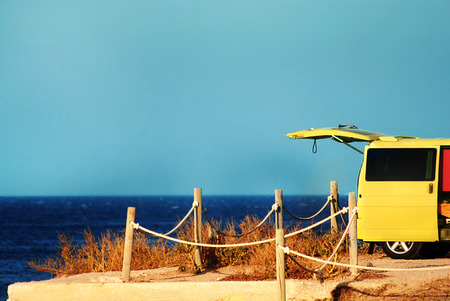 view on sea: Yellow van by the sea