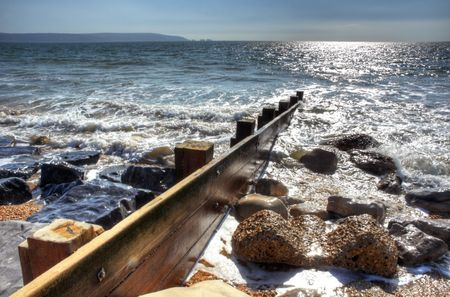 enhanced: Groyne with surrounding rocks enhanced to HDR effect