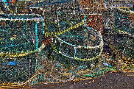 lobster pots: Lobster pots stacked on quayside in winter time