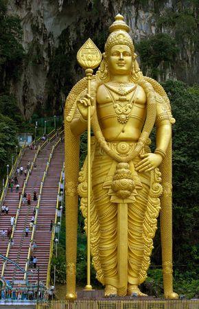 kavadi: Statue of Lord Murugan with steps leading to Batu Caves
