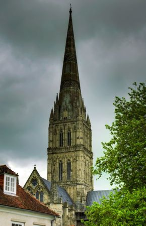 Spire of Salisbury Cathedral on an overcast day photo