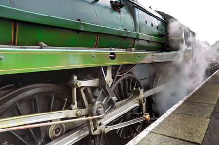 footplate: Old steam train engine releasing steam at alton station