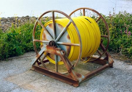 kimmeridge: Hose Pipe reel on large frame at Kimmeridge Dorset UK Stock Photo