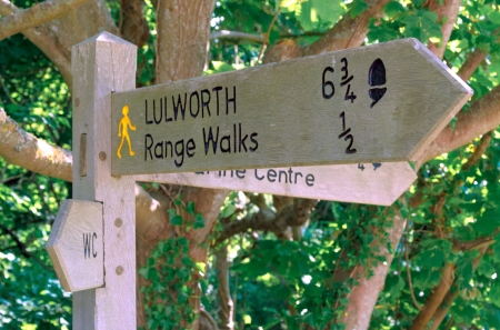 Signpost for Lulworth and Range walks at Kimmeridge Dorset UK photo