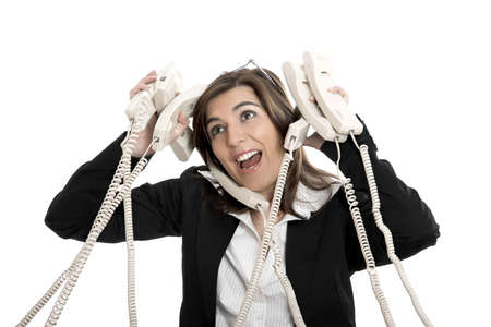 resignation: Busy woman working and answering a lot of calls at the same time Stock Photo