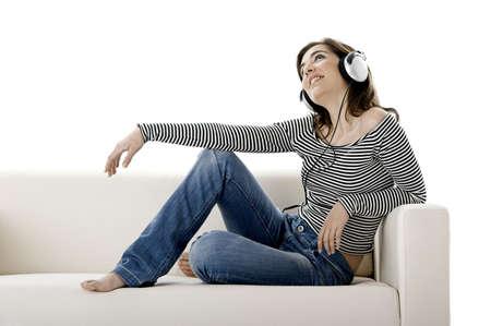 Beautiful happy woman listen music with headphones