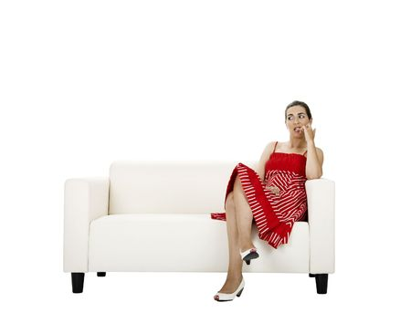 preety: Beautiful woman seated on a white couch biting her nails (with frightened and suspicious espression)