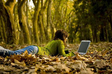 jungle girl: Beautiful young woman using laptop at outdoor Stock Photo