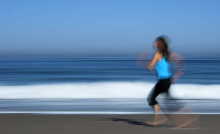 Young atractive woman running on the beach (motion efect) Stock Photo - 358859