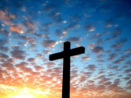 Cross in a cloudy sky