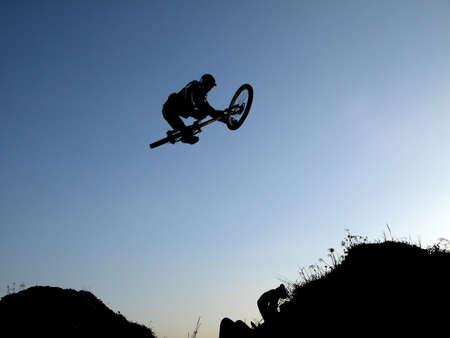 dual: Mountain bike jump Stock Photo