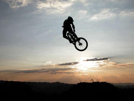 flight helmet: Mountain bike jump Stock Photo