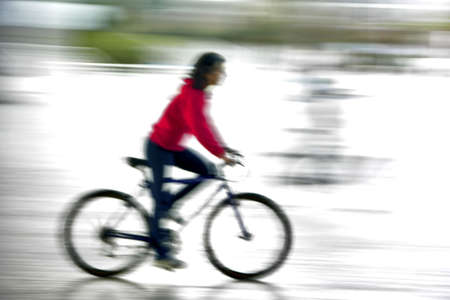 btt: Girl riding is bike in motion effect